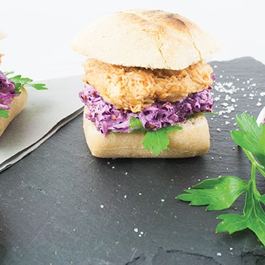 Mini sandwiches with cooked shredded duck and red cabbage salad -